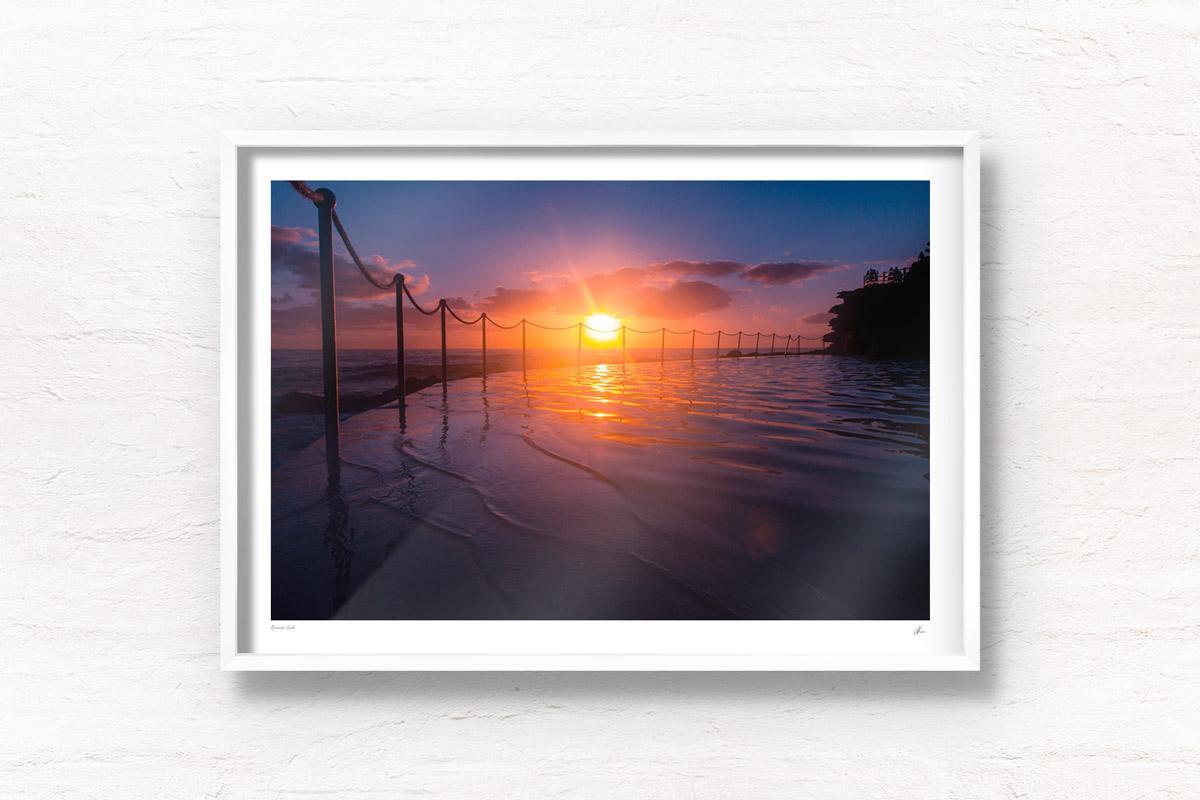 Stunning silhouetted sunrise over Bronte Rockpool