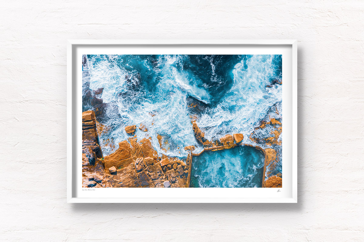 Aerial seascape above an empty icy cold Mahon Pool, Maroubra