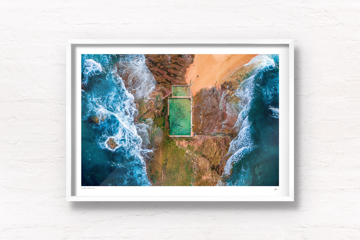 Aerial seascape above the crashing waves onto Mona Vale Rockpool