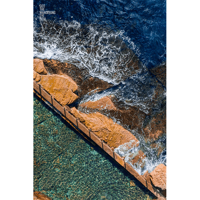 Aerial beach shot above the seaside oceanpool of McIvers baths, Coogee