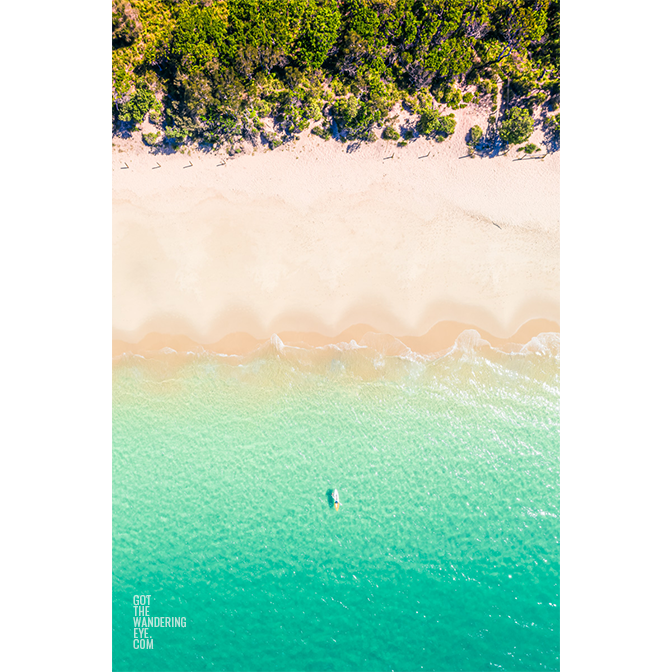 Aerial oceanscape overlooking a kayaker paddling to the beautiful South Coast's Jibbon Beach