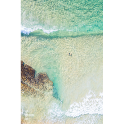 Man enjoying, and floating in the shallow surf at Maroubra Beach