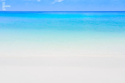 Long exposure photograph of the beautiful crystal clear blue waters at the beach at the Maldives
