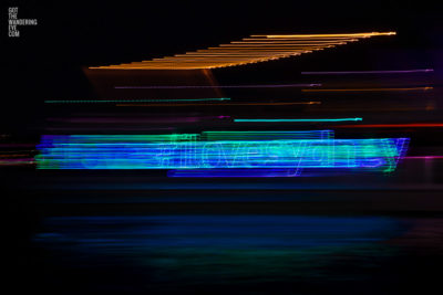 Long exposure, light painting photography of Vivid Festival. Light trails of Sydney Harbour, Australia