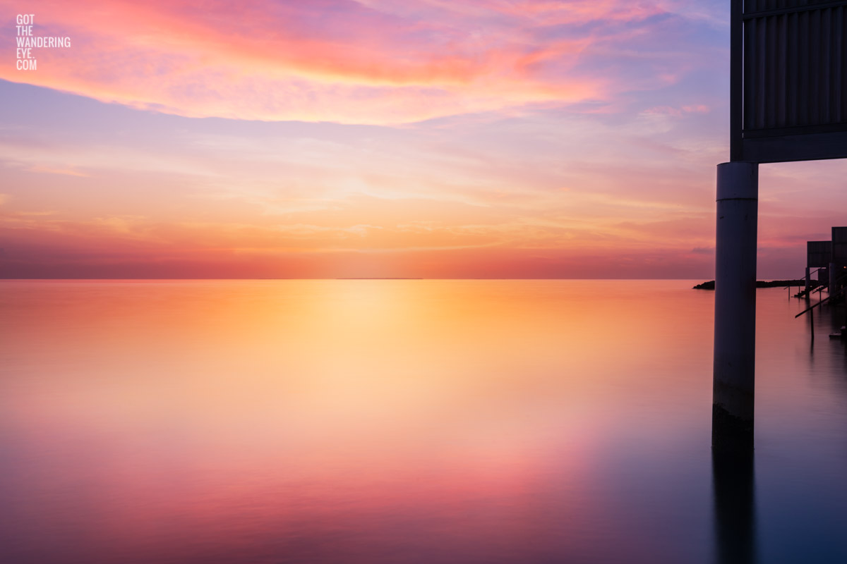 Fine Art Photography Print. Spectacular golden sunrise over silky ocean in the Maldives