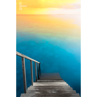 Incredible long exposure photograph of a sunrise over the indian ocean, Maldives. Taken from the steps of overwater bungalow.