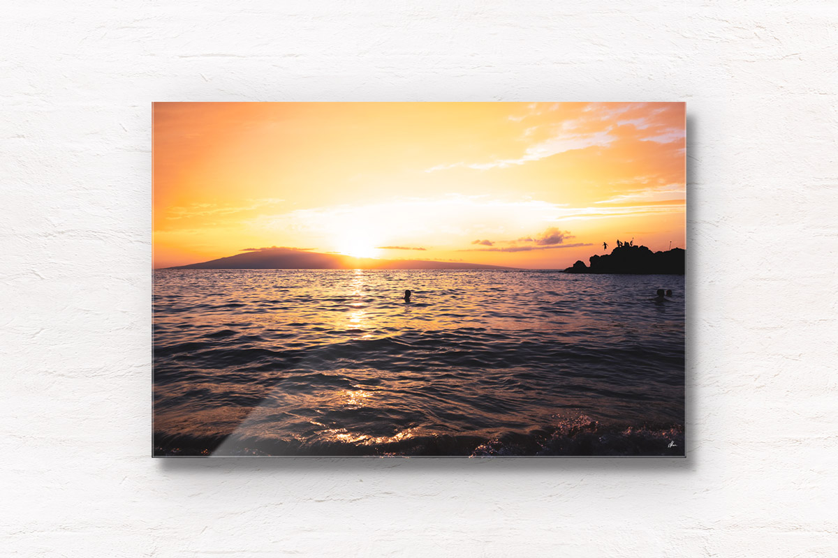 Fine Art Photography Print. Spectacular golden sunset dipping into the ocean at Black Rock, Maui, Hawaii