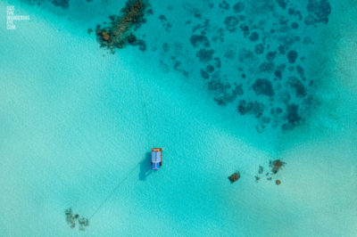 Aerial oceanscape image of boat anchored in the island paradise of the Maldives.