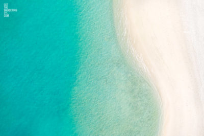 Aerial oceanscape close up of the crystal clear waters and sandy white beach of the Maldives