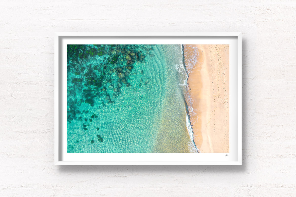 Aerial oceanscape above the Bogey Hole and turquoise waters of Bronte Beach