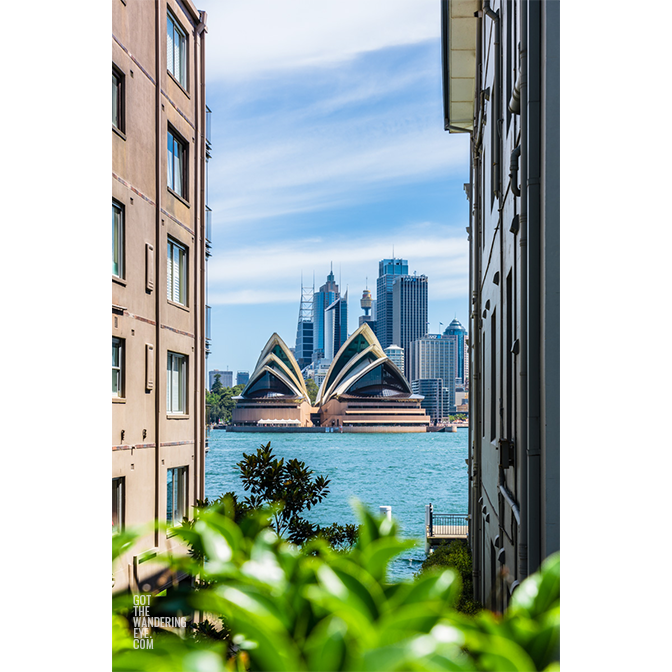 Looking through buildings to Sydney Harbour and Opera House