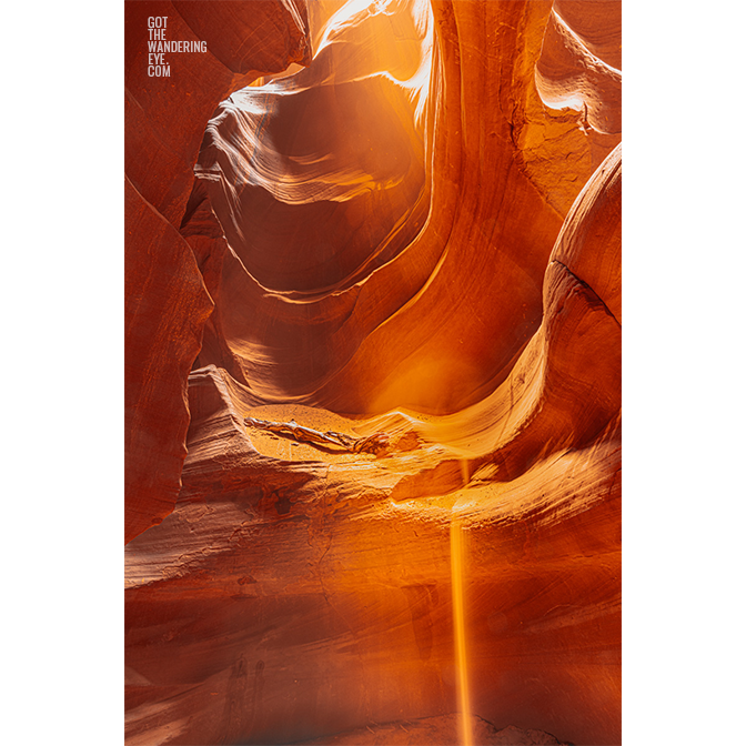 Sand falling from the sandstone slot canyon in Antelope Canyon, Arizona