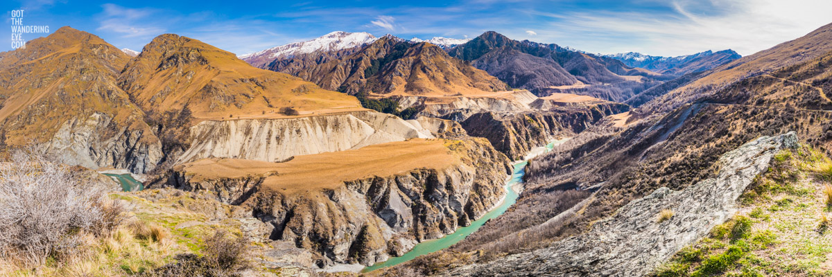 Panoramic of Skippers Canyon, one of New Zealand's richest gold-bearing rivers, with snow capped mountains