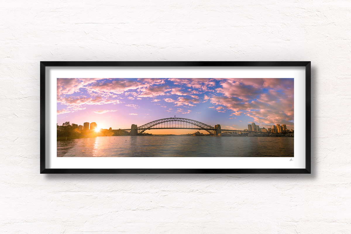 Panoramic view of a stunning sunrise and pink sky behind the Sydney Harbour Bridge Silhouette