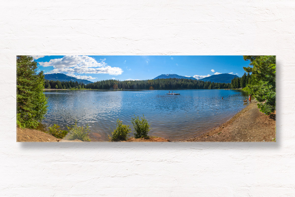 Panoramic view of gorgeous lake with mountains in Whistler, Canada