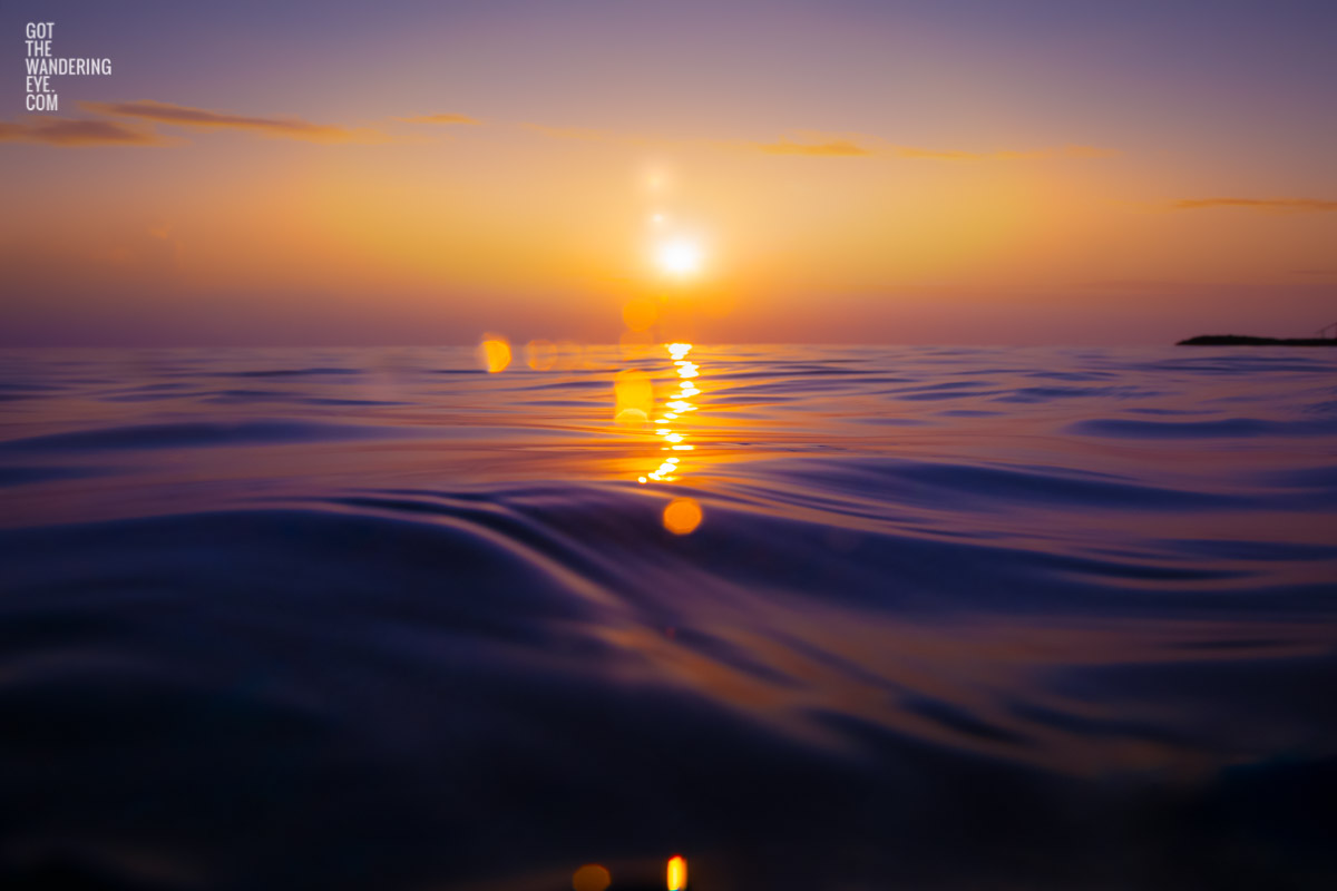 Stunning bokeh sunrise rising over the ocean waters of the Maldives