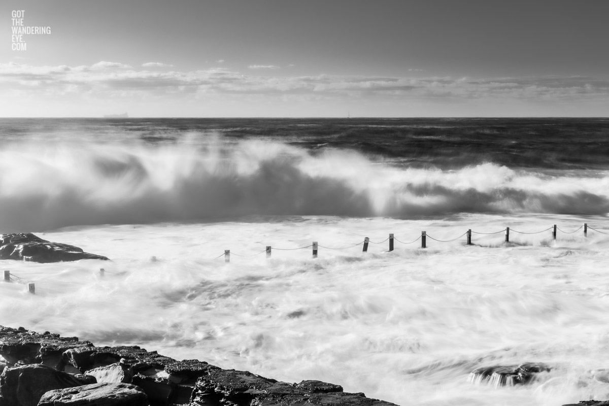 Black & White image of huge waves crashing over Mahon Pool, Maroubra