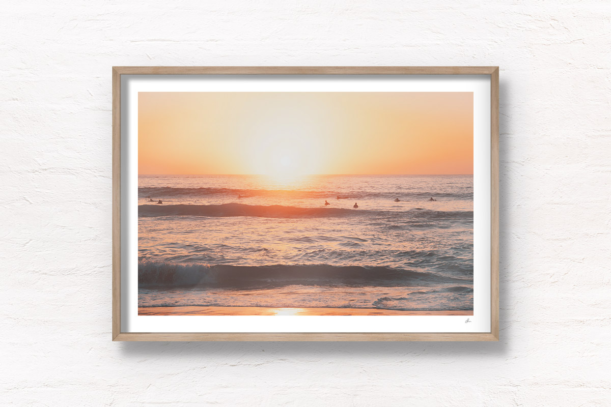 Surfers enjoying a beautiful early morning sunrise over Bondi Beach