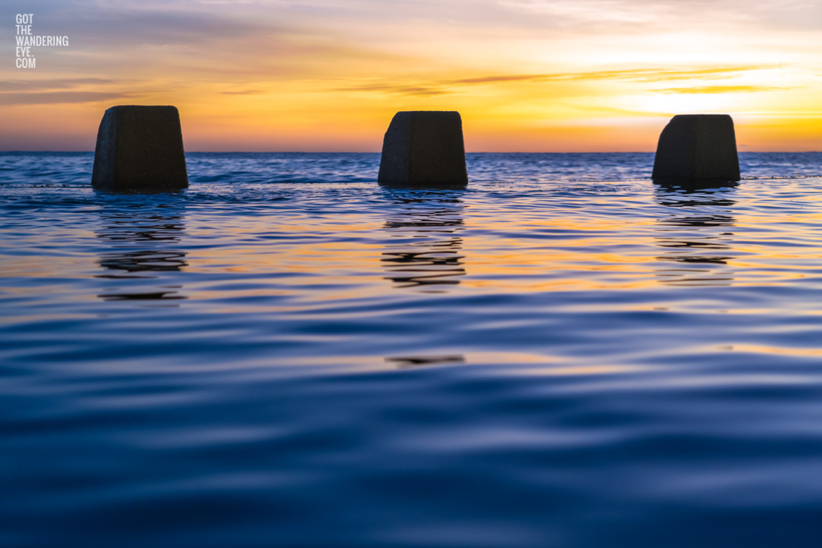 Close up of calm water and ocean ripples of The Ross Jones Memorial Pool at Coogee during a beautiful sunrise