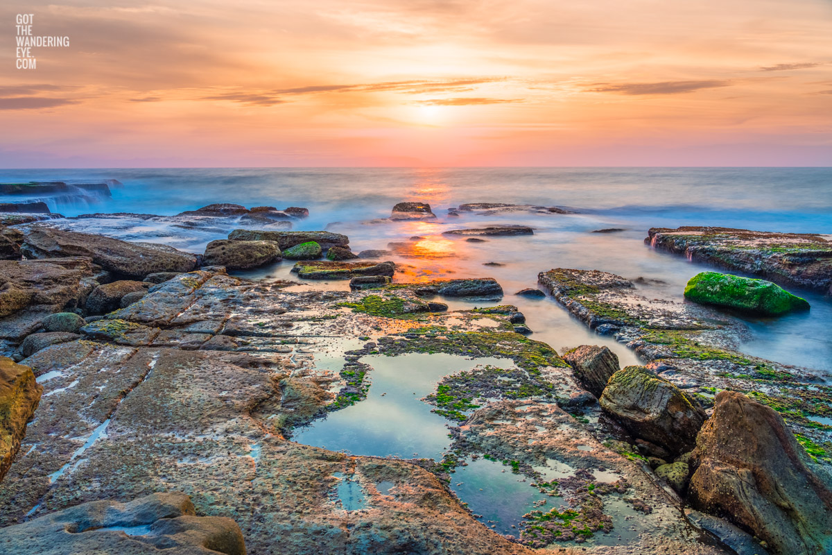 Sunrise over the ocean and puddles at Mahon Pool, Maroubra