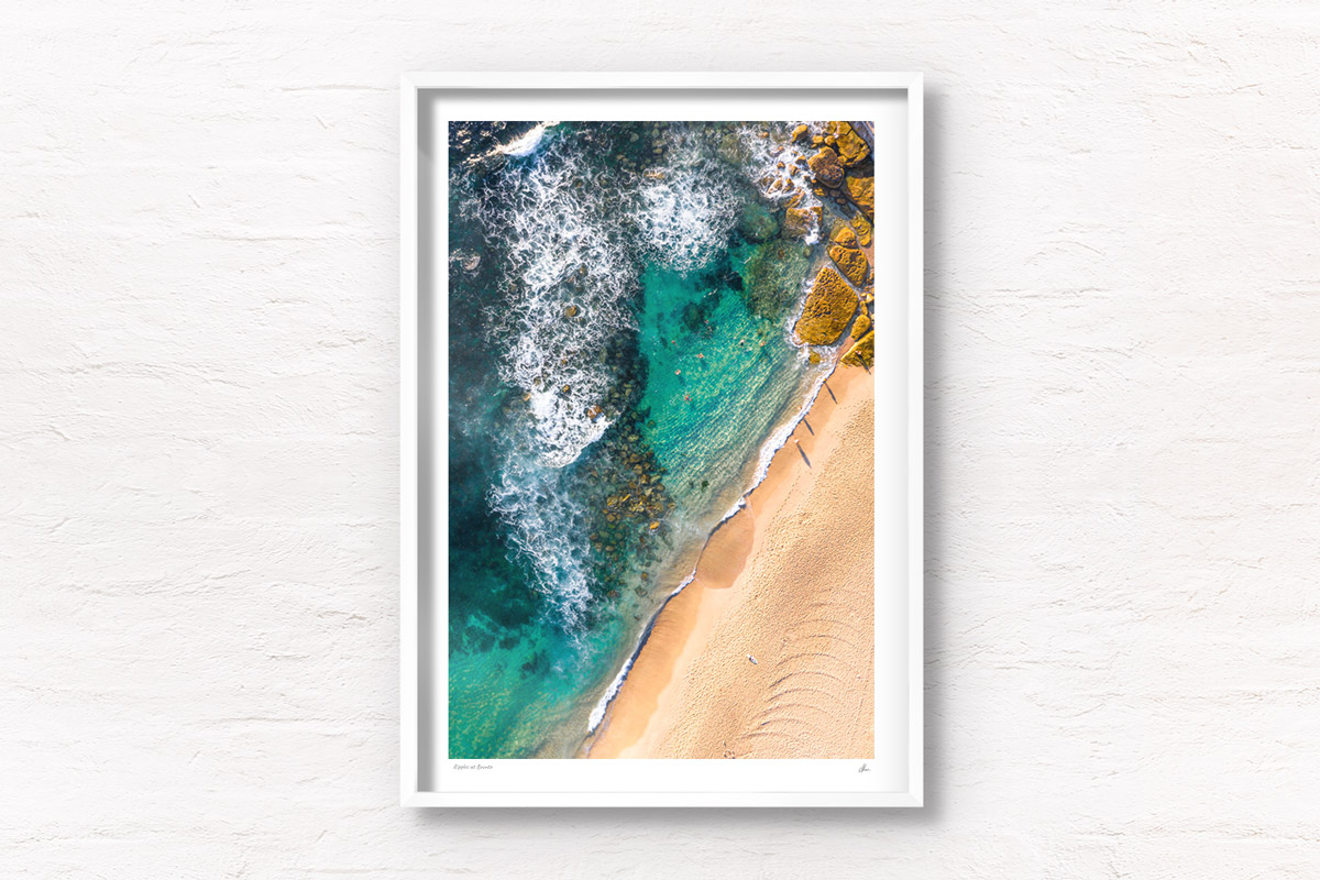 Aerial photograph of swimmers enjoying the Bogey Hole, Bronte Beach