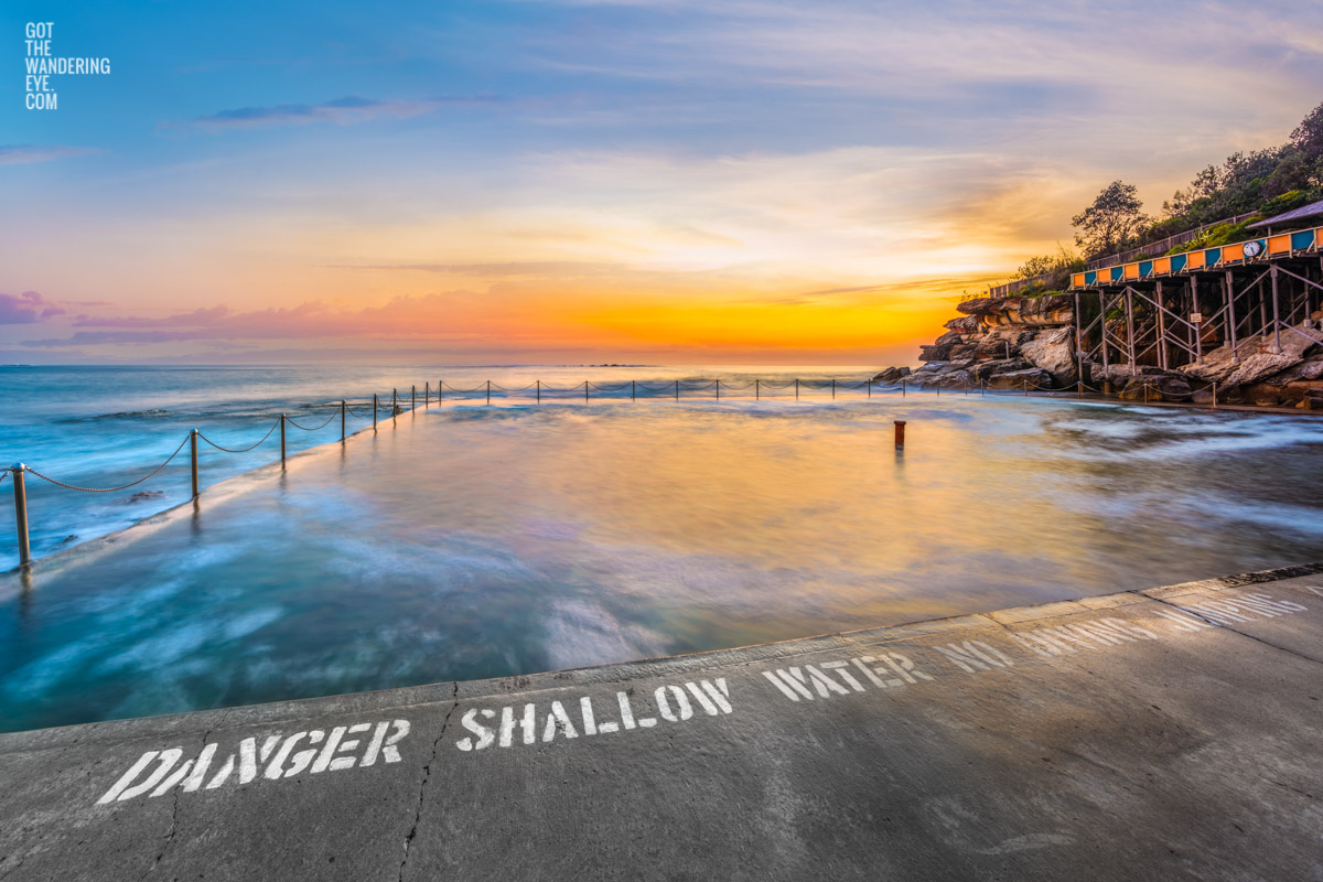 Long exposure of the sun rising over the iconic ocean pool, Wylies Baths in Coogee