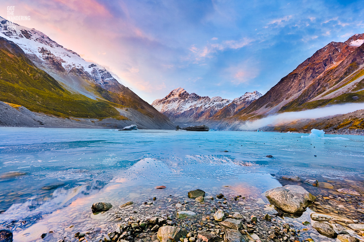 Frozen Hooker Lake with reflection of Aoraki / Mount Cook as the sunsets in New Zealand