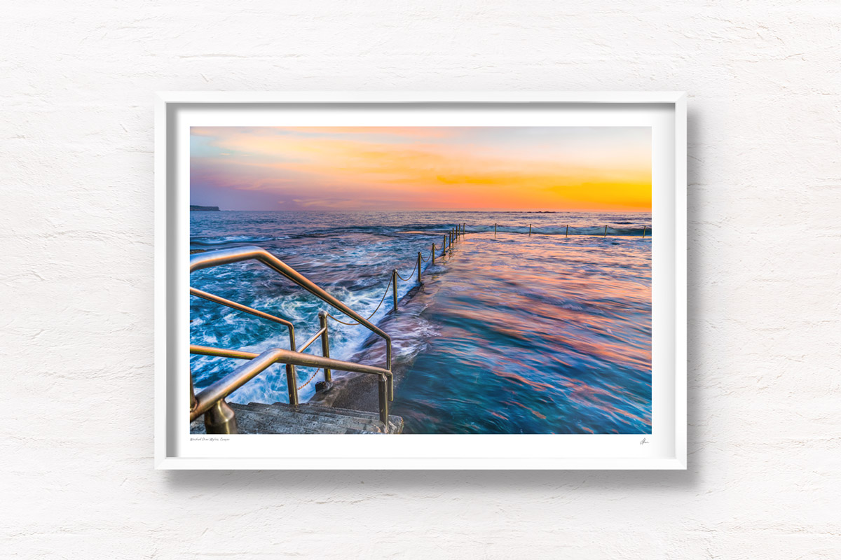 Long exposure photo of Wylies Baths ocean rockpool during sunrise at Coogee