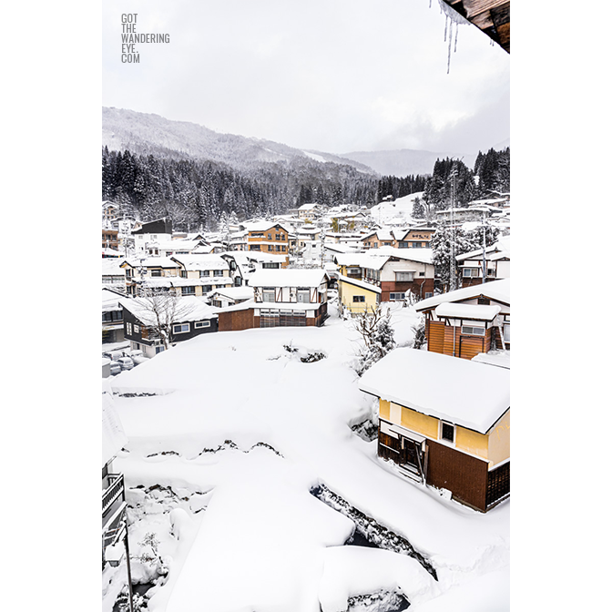Snowy mountain village. Nozawa Onsen, Japan buried under snow.