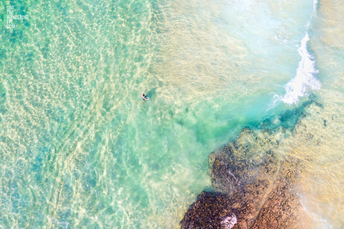 Aerial seascape of lone swimmer on Maroubra Beach
