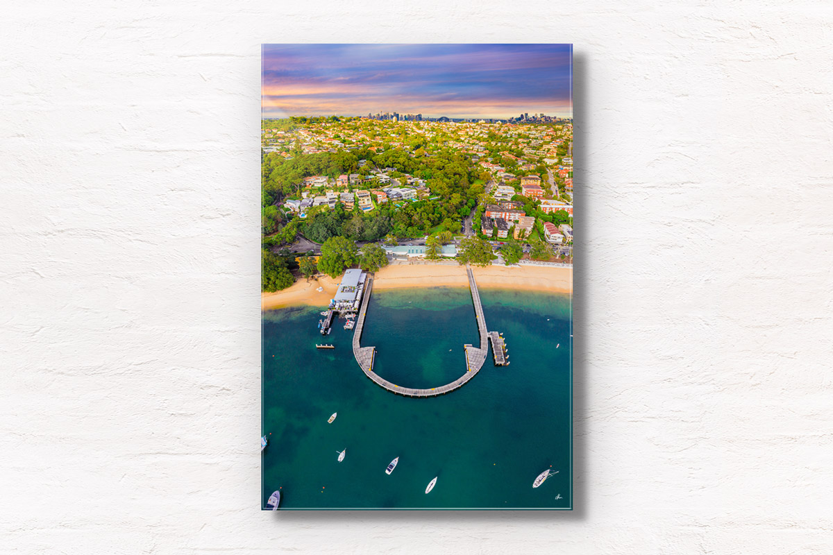 Aerial seascape above Balmoral Beach with the Sydney skyline in the horizon