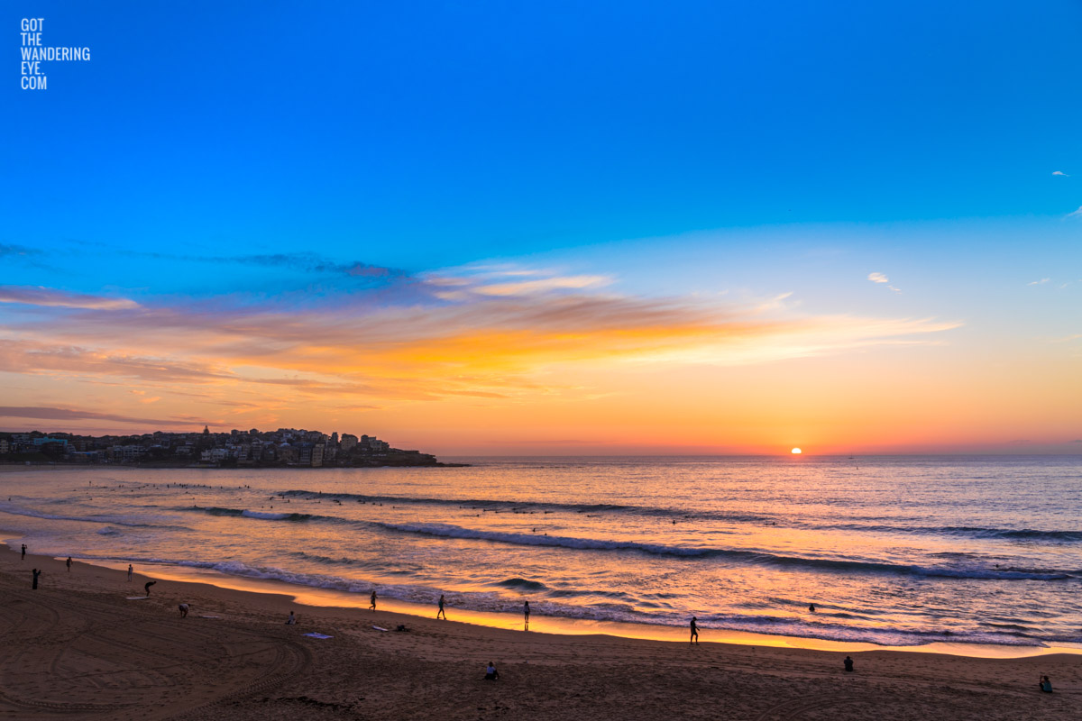 Locals stop and stare at a gorgeous sunrise over Bondi Beach