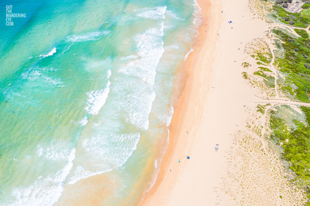 Aerial seascape above Curl Curl Beach on a hot Summers day