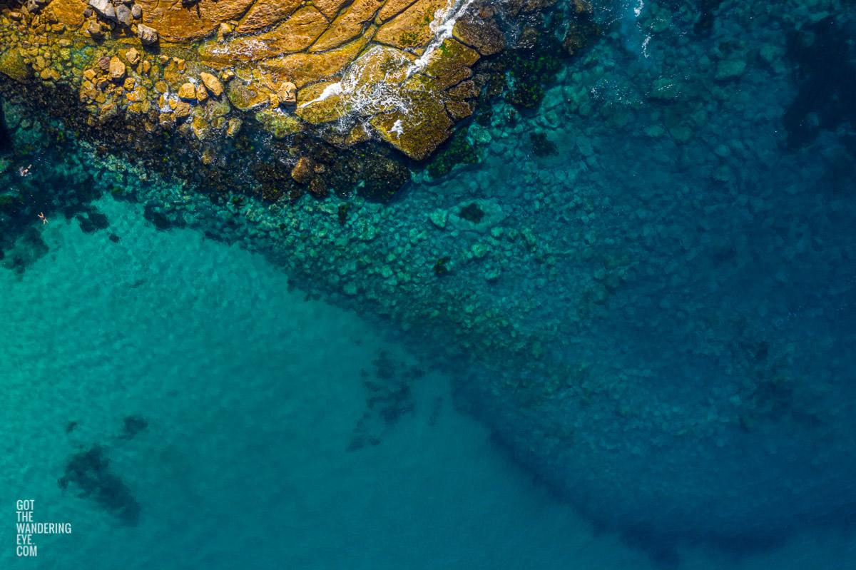 Aerial seascape above swimmers enjoying Flat Rock North Bondi