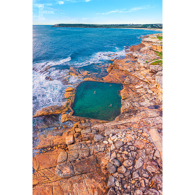 Aerial seascape above swimmers in Mahon Pool, Maroubra on Summers Day.