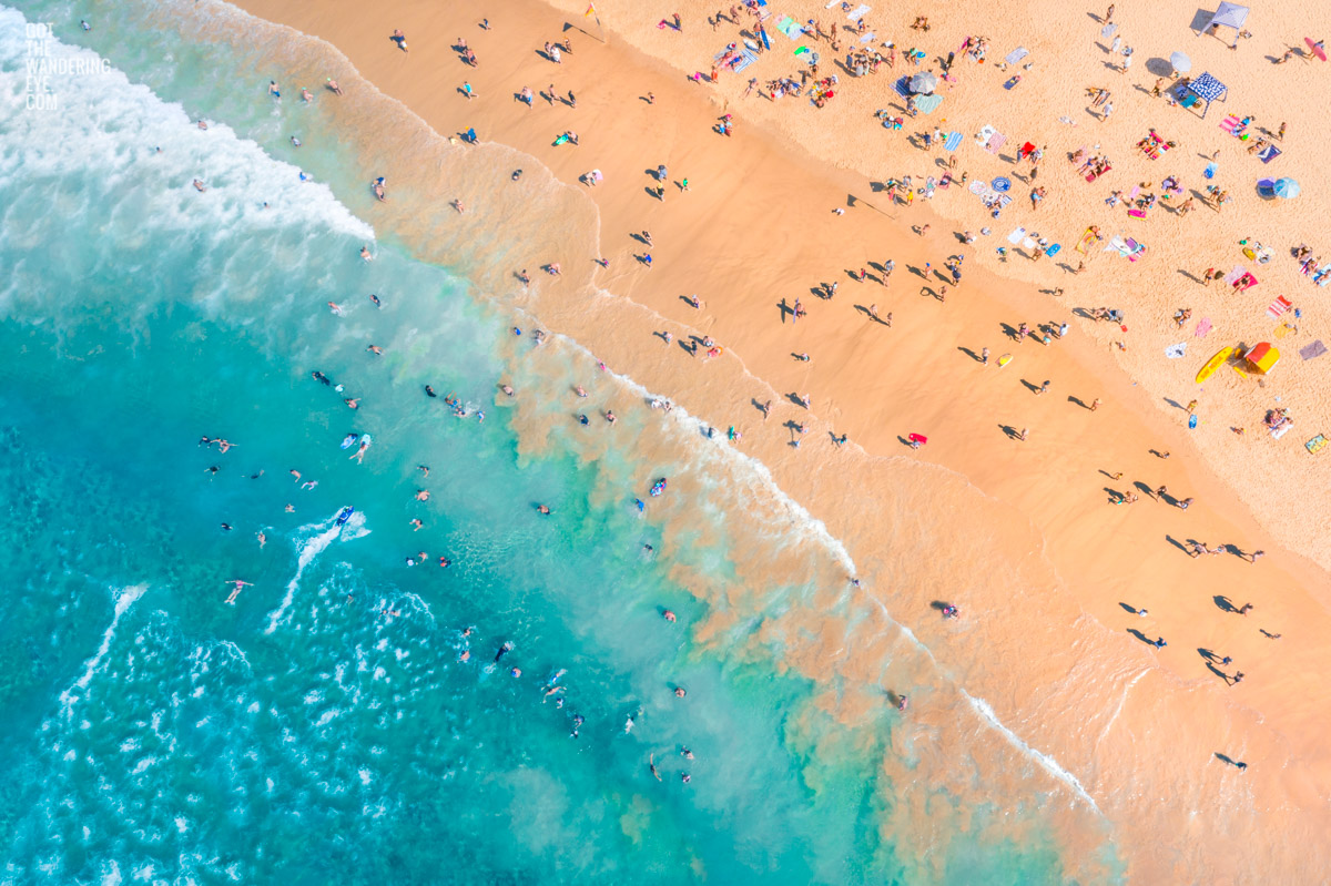 Aerial seascape above a packed Bondi Beach on a gorgeous Summers Day.