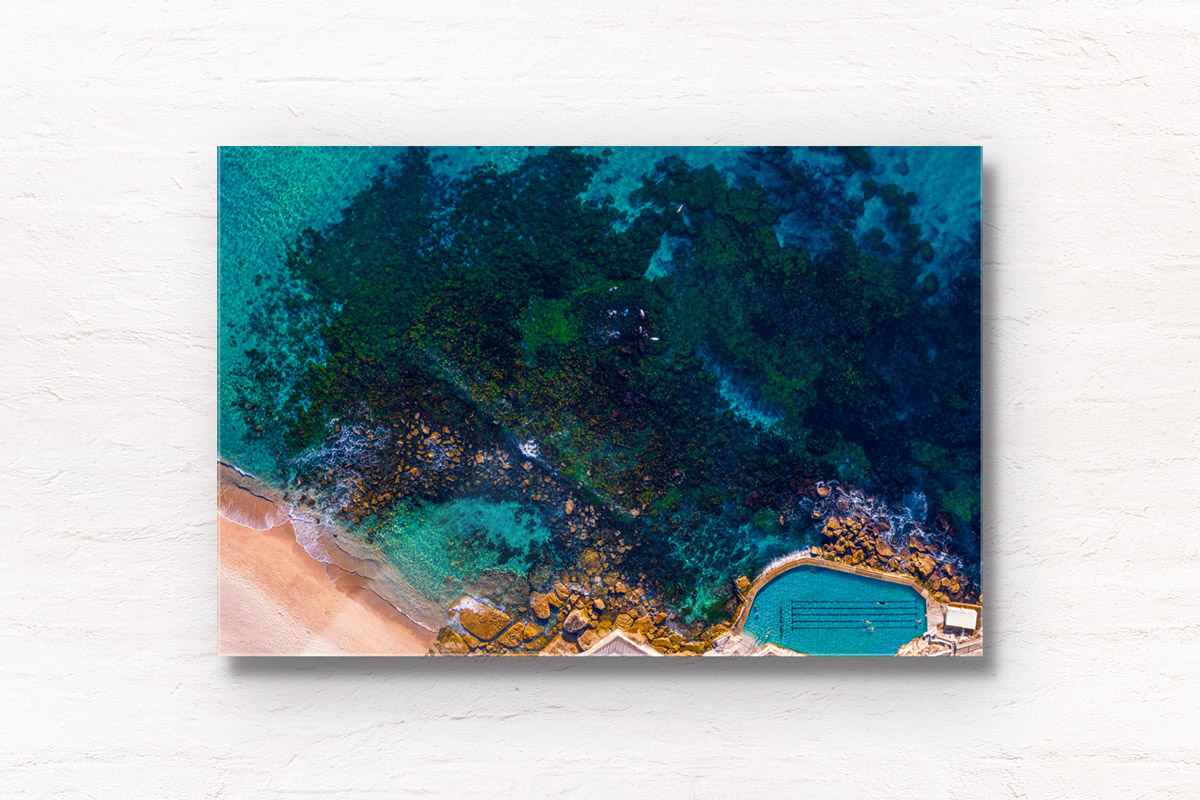 Aerial seascape above the blue waters of Bronte Beach Rockpool.