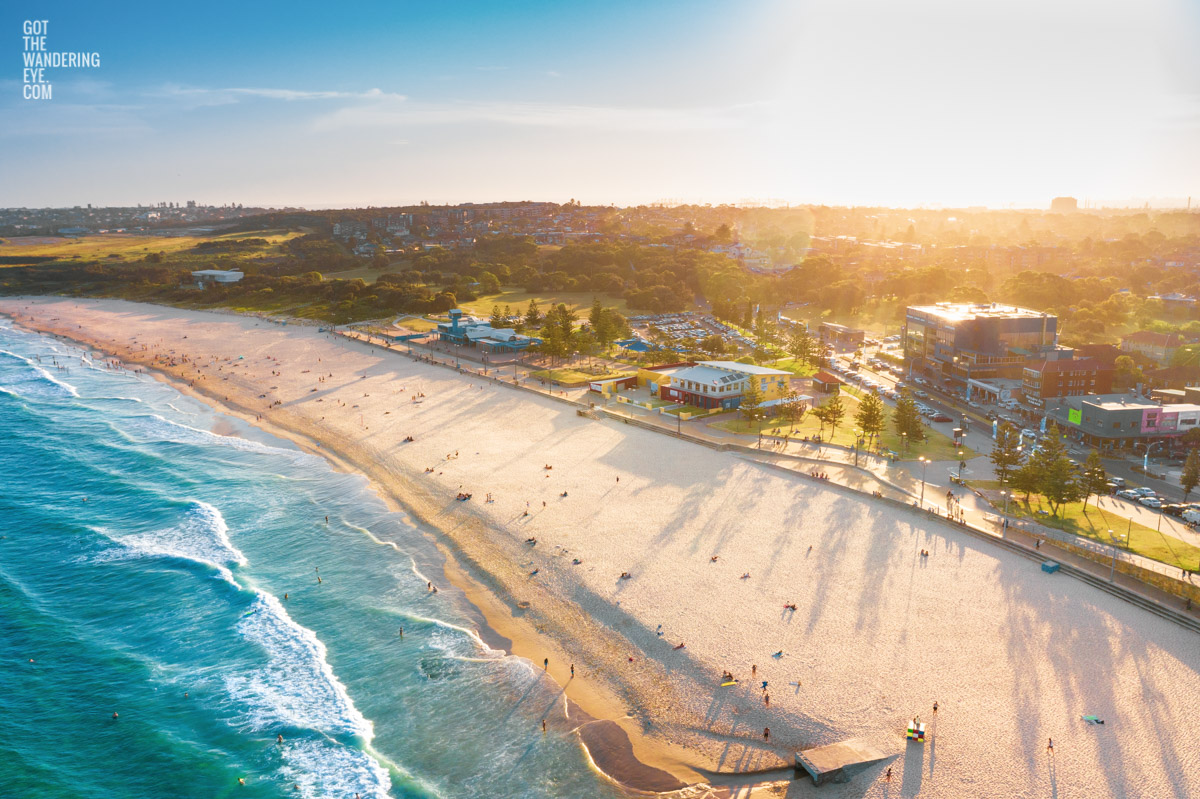 Aerial shot of a gorgeous golden sunset creating long soft shadows over Maroubra Beach, Sydney