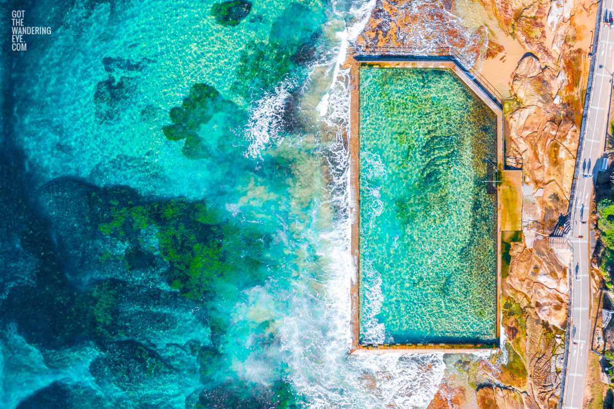 Aerial oceanscape above crystal clear waters of South Cronulla Beach Rockpool