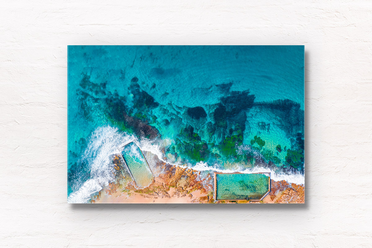 Aerial oceanscape above crystal clear waters of Cronulla Beach Rockpools