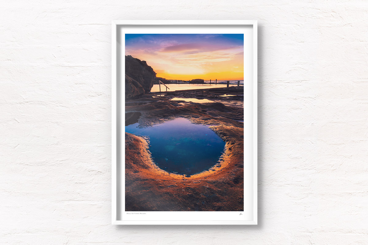 Fiery purple sky sunrise in a puddle of water at Mahon Pool, Maroubra