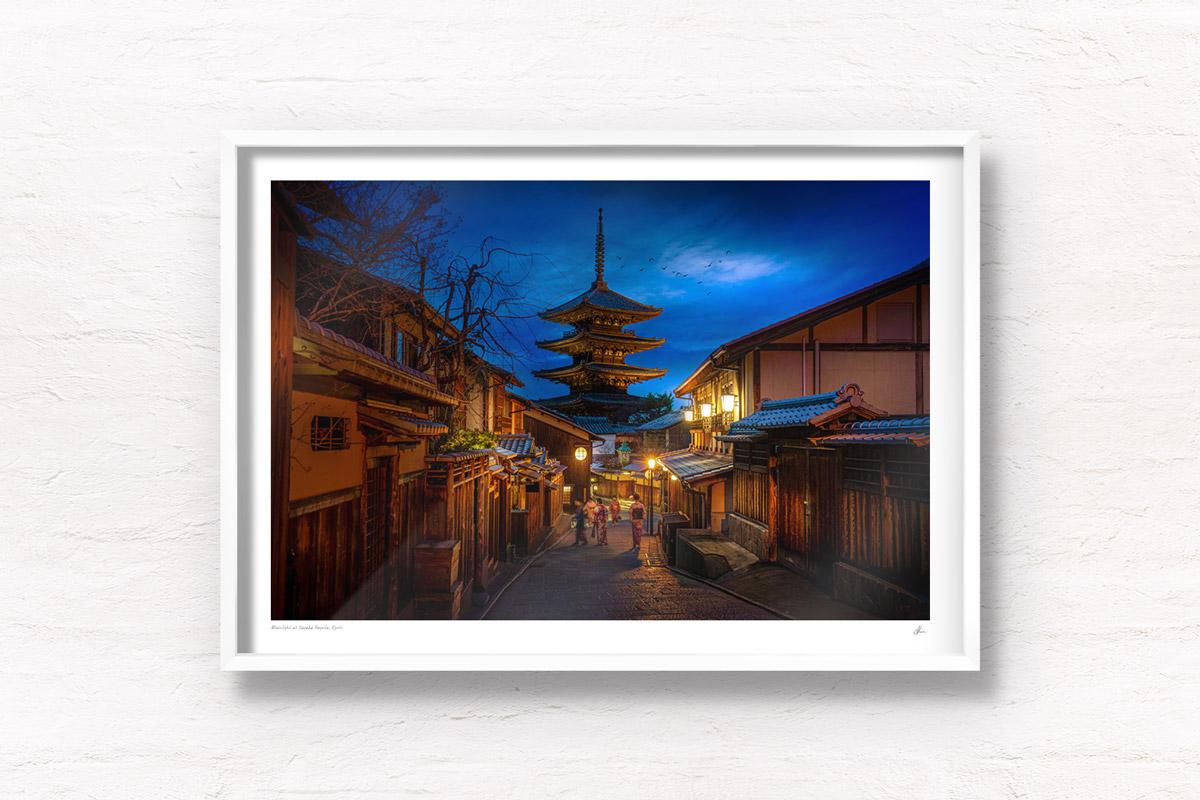 Woman walking in kimonos under the beautiful moonlight and lit lanterns in the Higashiyama District at Yasaka Pagoda, Kyoto, Japan
