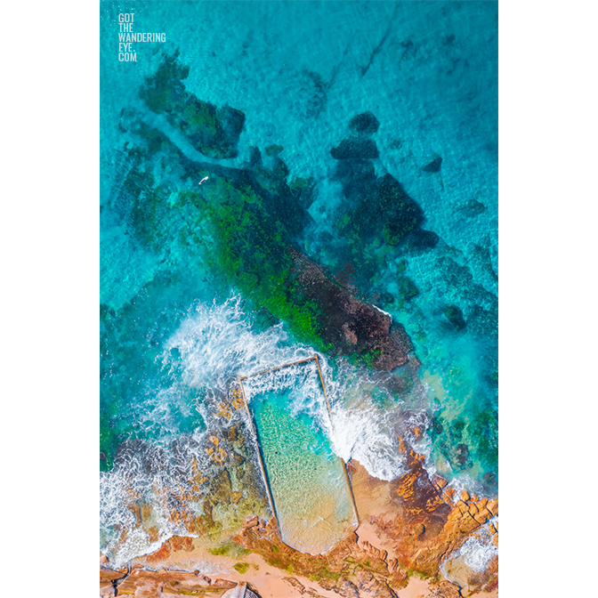 Aerial oceanscape above crystal clear waters of North Cronulla Beach Rockpool