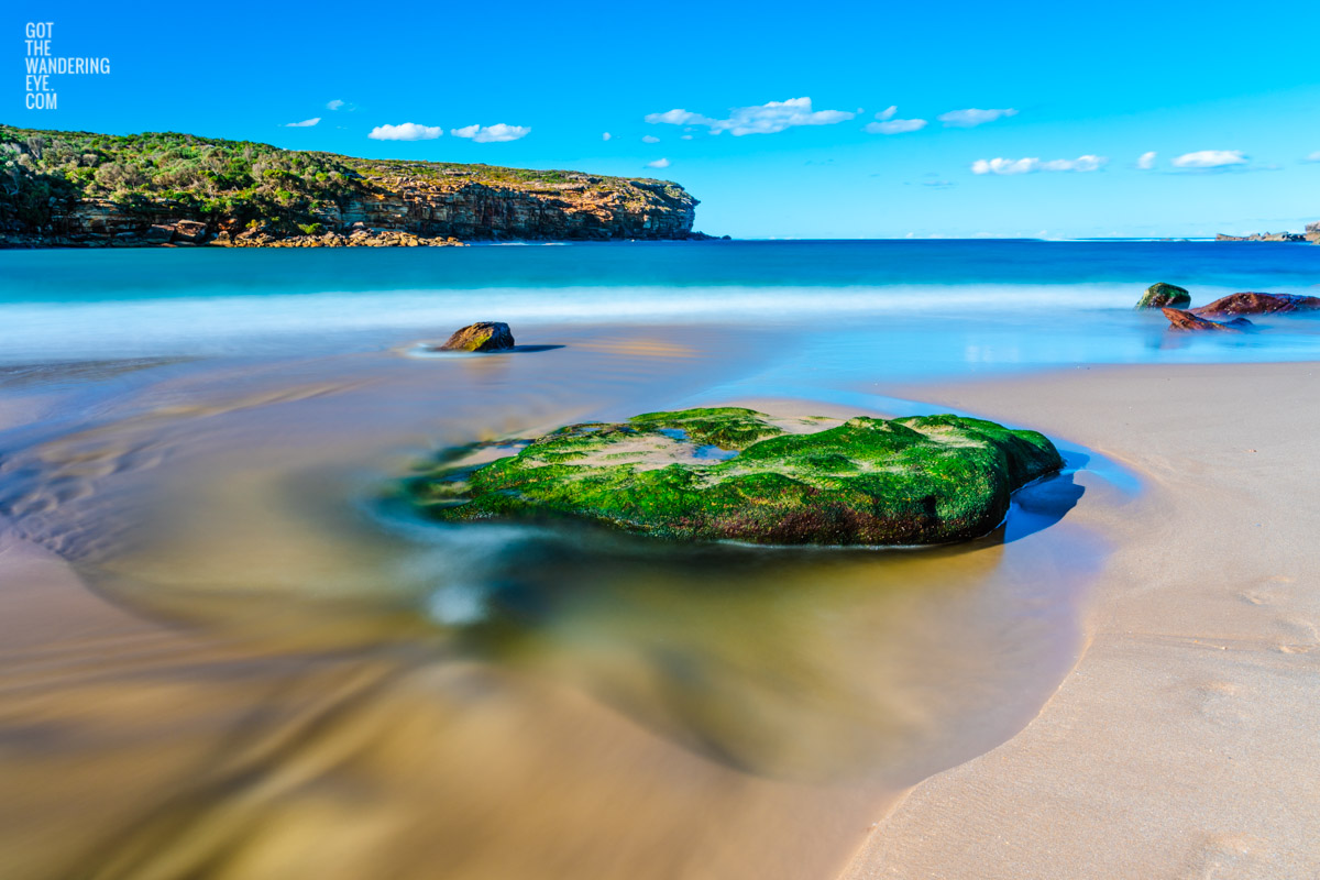 Gorgeous long exposure of silky waters of Wattamolla Beach in the Royal National Park