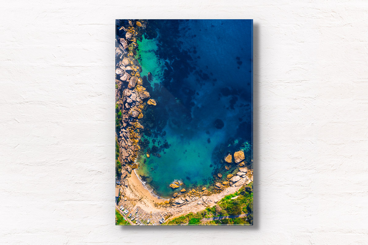 Aerial seascape above the gorgeous turquoise ocean waters of Gordons bay