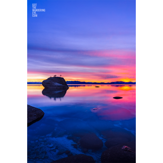 Long exposure of a beautiful pink and purple sky sunset at Bonsai Rock, Lake Tahoe
