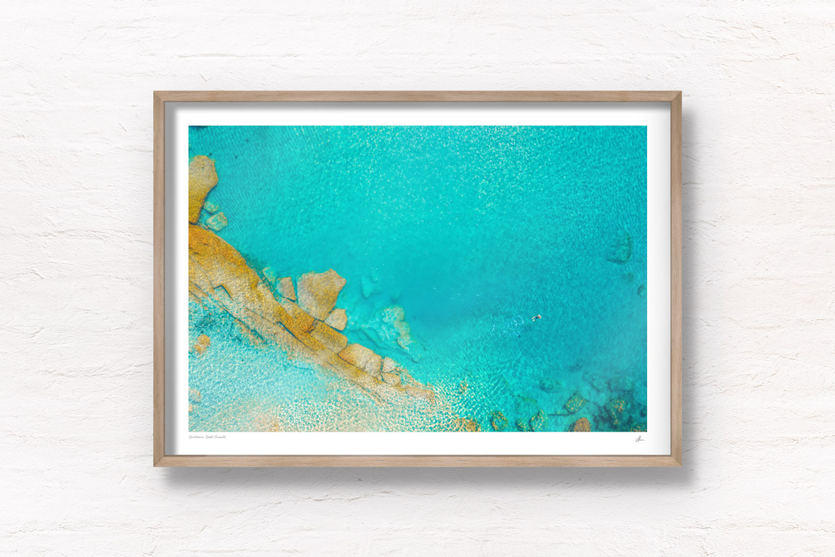 Framed print, fine art of a eerial oceanscape above turquoise crystal clear waters of South Cronulla Beach.