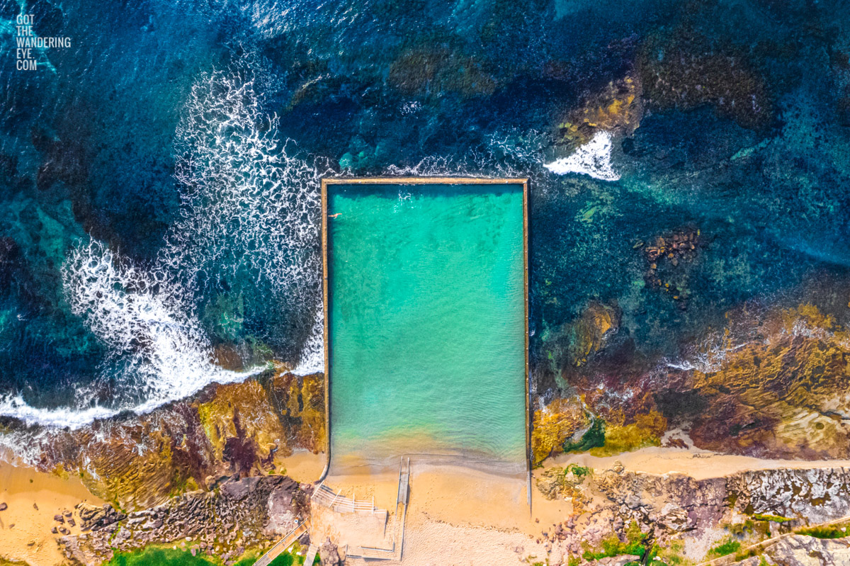 Aerial oceanscape lone swimmer enjoying Shelly Beach Rock, Ocean Pool in Cronulla