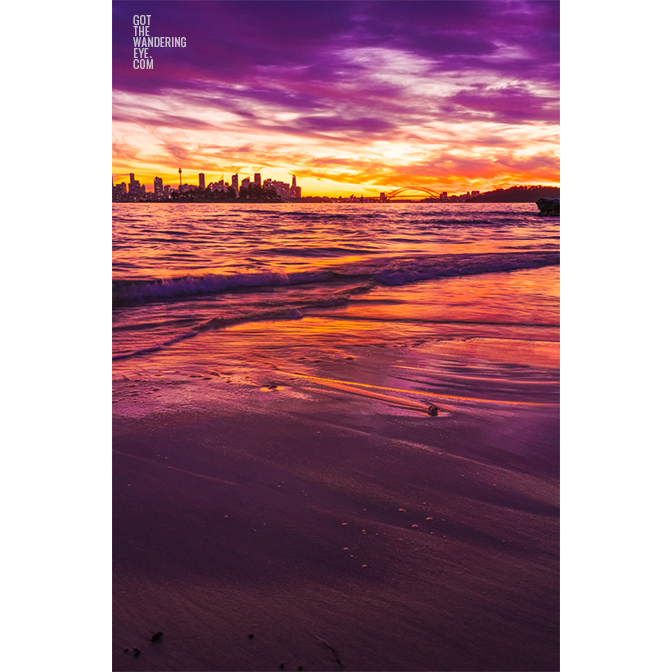 Long exposure of a gorgeous pink sky sunset, creating a silhouette over the Sydney skyline, taken from Milk Beach Vaucluse.
