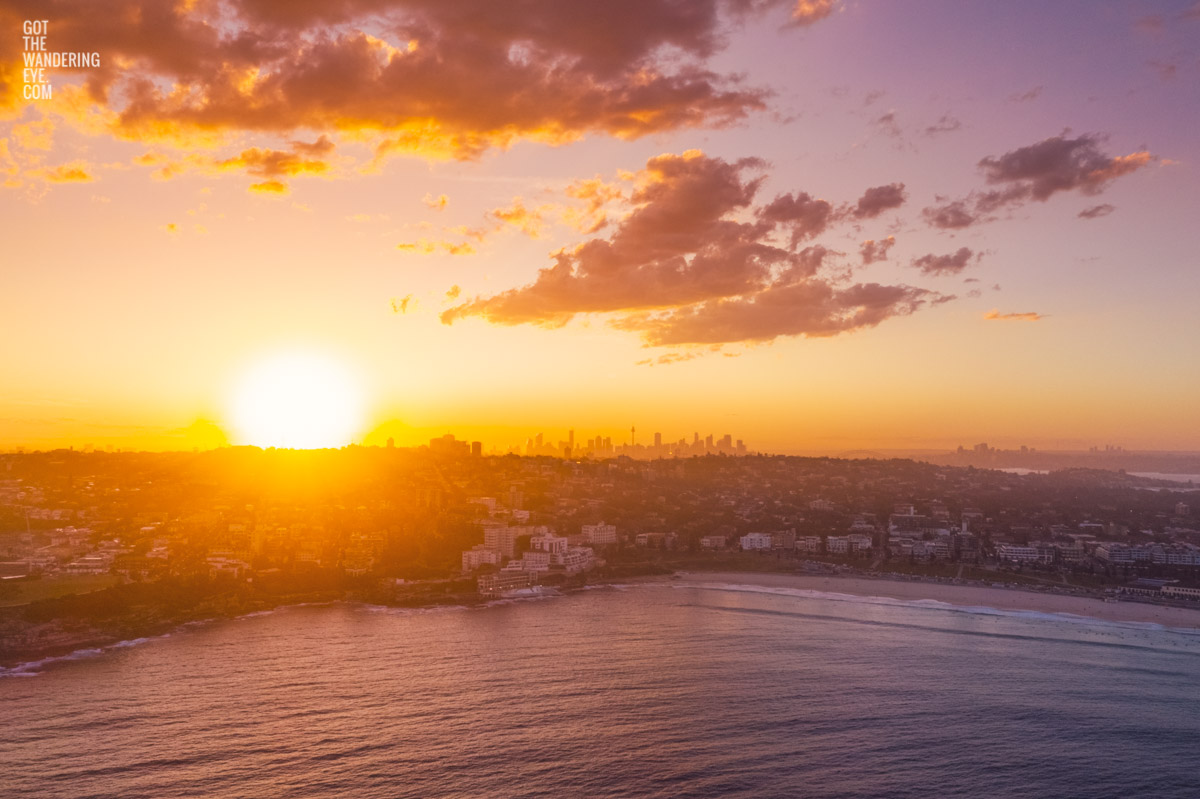 Aerial view of a gorgeous sunset over the Sydney skyline from Bondi Beach. beach, ocean, sunset